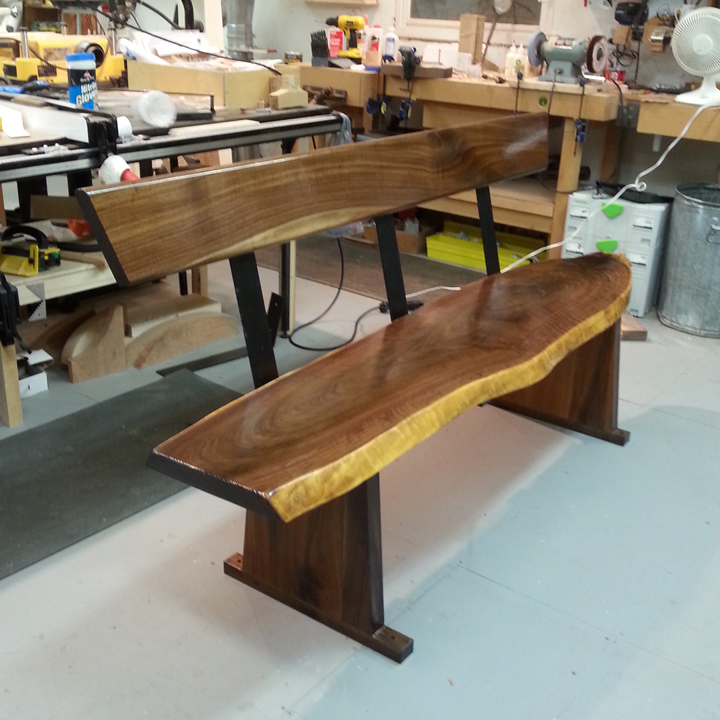 Walnut slab bench installed.